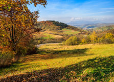 Autumn landscape with meadow and village  in mountains Stock Image