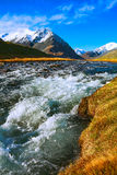 Autumn landscape mountain river with rapid current of water flow Stock Images