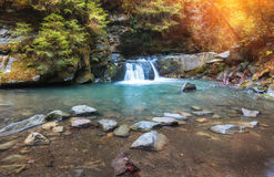 Autumn landscape mountain river with small waterfall and rapids. Autumn landscape. Beautiful fall scene on a clear mountain river with small waterfall and Royalty Free Stock Image