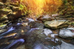 Autumn landscape mountain river with small waterfall and rapids. Stock Photo