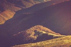 Autumn landscape in mountain valleys. Stock Photos