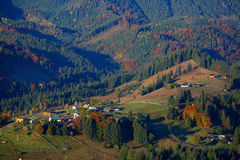 Autumn landscape with mountain village Stock Photos