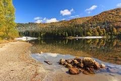 Autumn landscape in the mountains,Saint Ana lake,Transylvania,Ro. Majestic autumn landscape,St Anna lake,Transylvania,Romania Royalty Free Stock Image