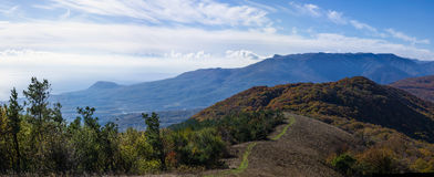 Autumn landscape in the mountains. With sea, clouds and fogs Stock Photos
