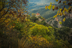 Autumn landscape with multicolored trees and small church. gorge Stock Image