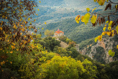 Autumn landscape with multicolored trees and small church. gorge Royalty Free Stock Photo