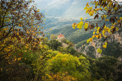 Autumn landscape with multicolored trees and small church. gorge Royalty Free Stock Image