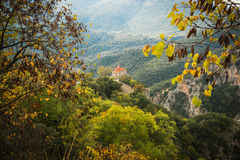 Autumn landscape with multicolored trees and small church. gorge Stock Photography