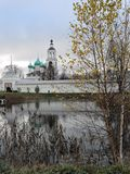 Autumn landscape, old church of Tolgsky monastery on the shore of a quiet pond. Autumn landscape, old church of Tolgsky monastery Stock Photos
