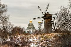 Autumn landscape with old wooden windmill. Royalty Free Stock Image