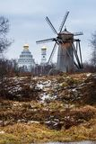 Autumn landscape with old wooden windmill. Stock Photos