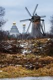Autumn landscape with old wooden windmill. Royalty Free Stock Images
