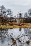 Autumn landscape with old wooden windmill. Royalty Free Stock Photos