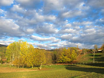 Autumn landscape with pictorial clouds Stock Image