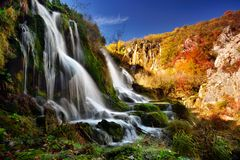 Autumn landscape in Plitvice Lakes National Park, Croatia‎. Waterfall with autumn trees stock photo