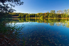 Autumn landscape with the pond Stock Photos