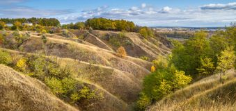 Autumn landscape - the ravine hills descending to the river valley. Near the river Siverskyi Seversky Donets in Ukraine Royalty Free Stock Images