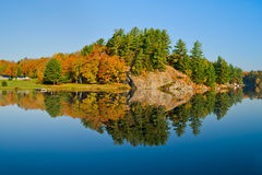 Autumn Landscape with Reflection. Autumn landscape with colourful trees reflecting in a calm lake royalty free stock photos
