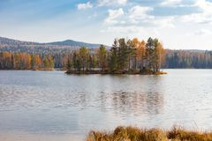 Autumn landscape with a reflection in the lake. Ural, Russia Royalty Free Stock Image