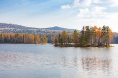 Autumn landscape with a reflection in the lake. Ural, Russia Stock Photos