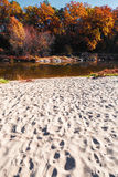 Autumn landscape with reflection in the river and empty beach Stock Photo