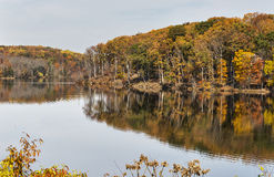 Autumn landscape with reflections in lake Stock Photos