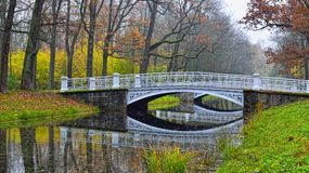 Autumn landscape with river and bridge in Catherine park, Pushki Royalty Free Stock Photos