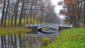 Autumn landscape with river and bridge in Catherine park, Pushki Stock Photos