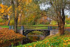 Autumn landscape with river and bridge in Catherine park, Pushki Stock Photography