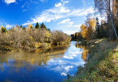 Autumn landscape with the river, the forest and the blue sky Stock Image