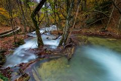 Autumn landscape, river in the mountains in the forest. The nature of Russia stock photo