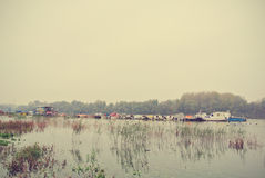 Autumn landscape on a river, on a rainy, foggy day; retro Stock Image