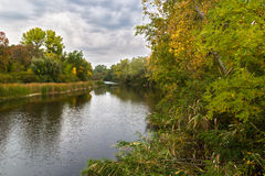 Autumn landscape with river and trees. Stock Image