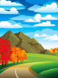 Autumn landscape with road. Colorful trees and mountain on a blue cloudy sky Stock Photography