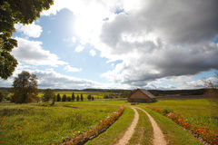 Autumn landscape with a road. And house Royalty Free Stock Photos