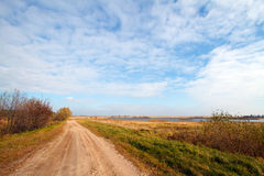 Autumn landscape with a road. And river Royalty Free Stock Image