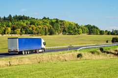 Autumn landscape with road and truck Stock Photo