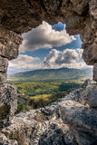 Autumn landscape ruined ancient walls on a hill against the blue sky in Crimea Stock Photography