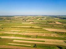 Rural landscape in autumn, farmland as seen from the bird`s eye view. Fields stretching to the horizon. Autumn landscape. Rural landscape and farmed fields stock images