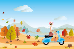 Autumn landscape and scooter woman Stock Images