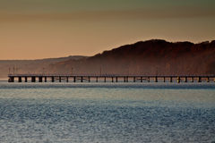Autumn landscape by the sea. Sunrise over the sea, view of the beautifully pier royalty free stock photos