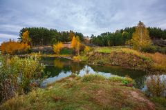 Autumn landscape. The Separate river a tributary of the Ob rive Royalty Free Stock Images