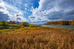 Autumn landscape. The Separate river a tributary of the Ob rive Royalty Free Stock Photo