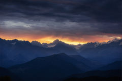 Autumn landscape and snow-capped mountain peaks. Royalty Free Stock Photography