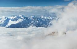 Autumn landscape and snow mountains in beautiful cumulus clouds. Main Caucasian Ridge. Type Mount Ushba Mheyer, Georgia Stock Images