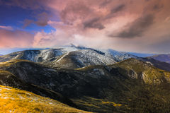 Autumn landscape in the snowy top mountains. Royalty Free Stock Photography