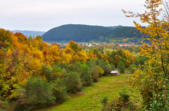 Autumn landscape. An autumn landscape with some hills and a cottage Royalty Free Stock Photo