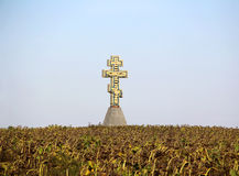Autumn landscape with sunflower and cross. Autumn landscape with faded sunflower and cross Stock Photo