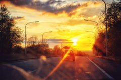 Autumn landscape with sunset road Royalty Free Stock Photo