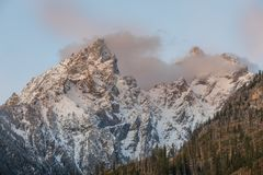 Autumn Landscape in the Tetons at Sunrise. A beautiful autumn landscape in the snow covered Tetons at sunrise Royalty Free Stock Photos